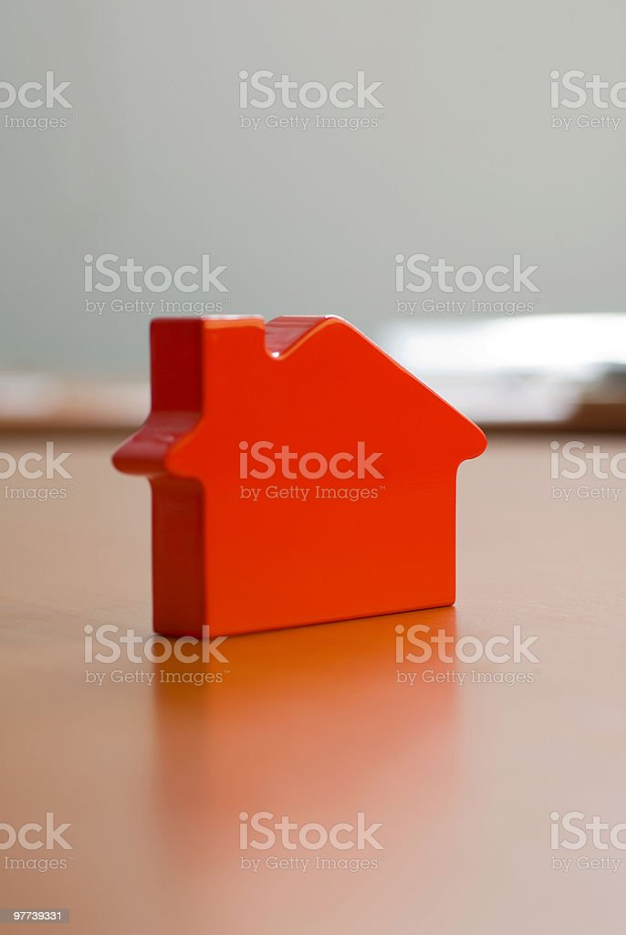 plastic miniature-house standing on a table, selective focus royalty-free stock photo