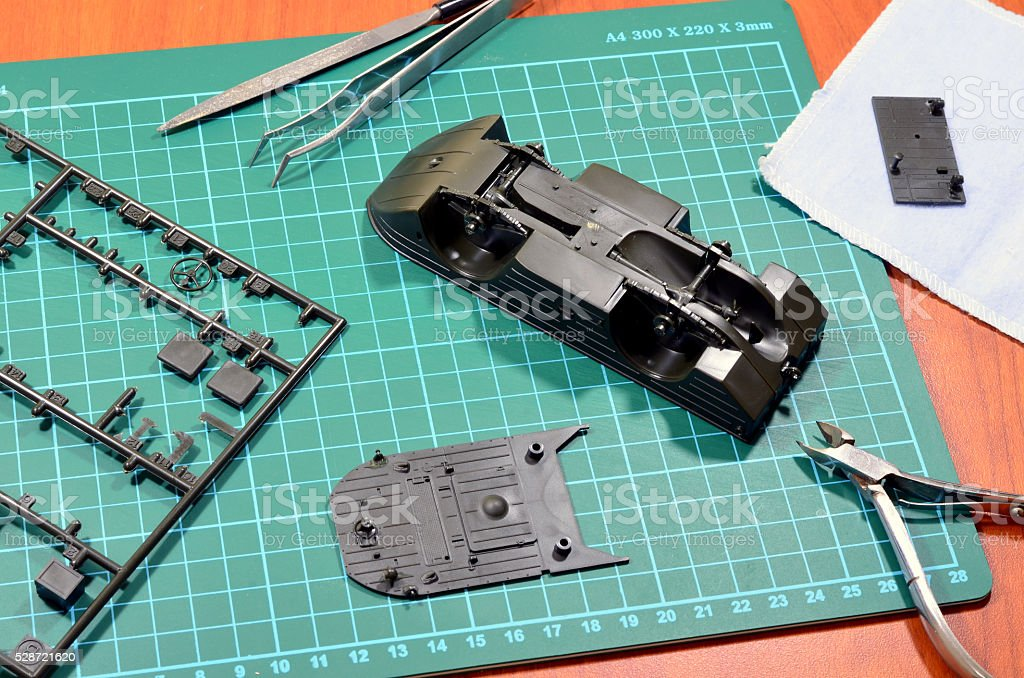 Plastic model under assembly. stock photo