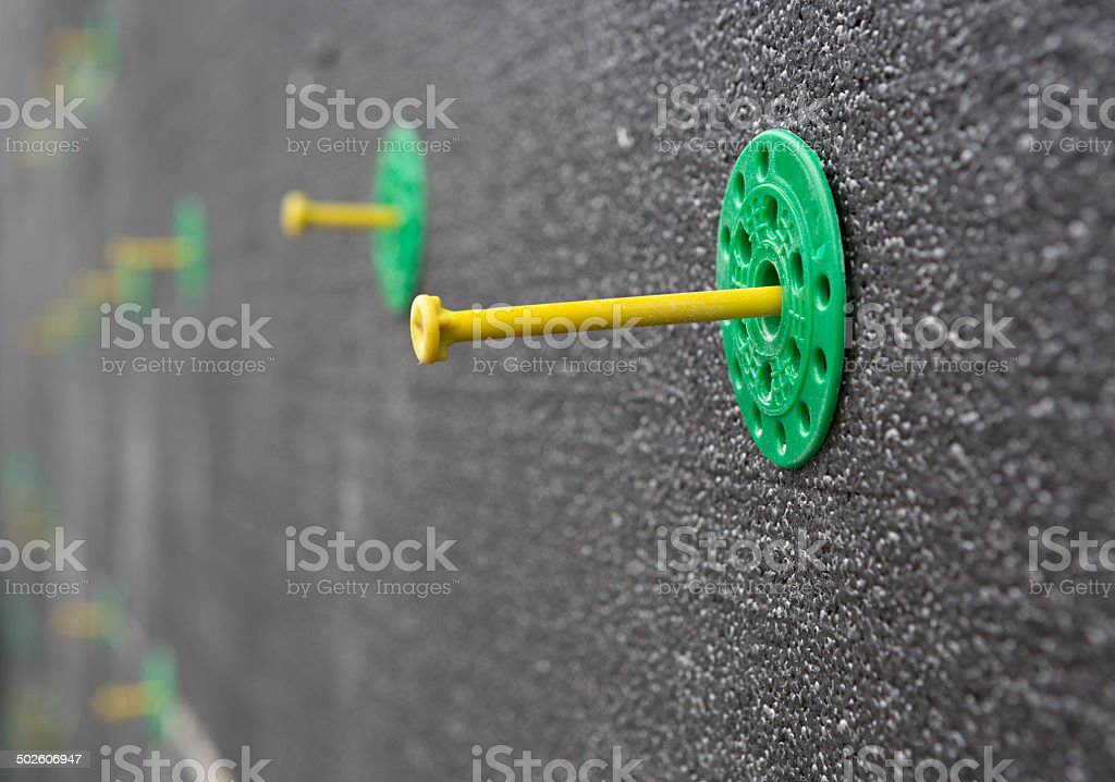 Plastic Nails to Fasten EPS on Wall stock photo