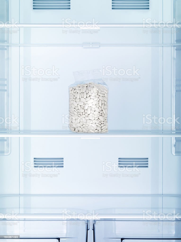 Plastic package full of beans in the refrigerator stock photo
