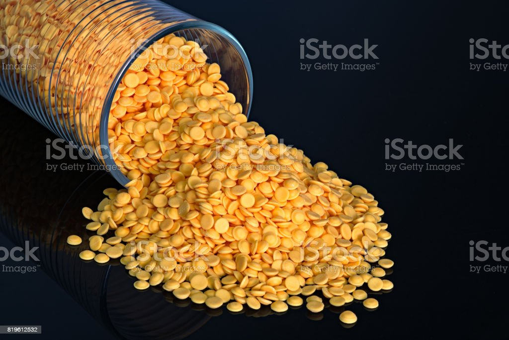 Plastic pellets, industrial beads on black color background stock photo