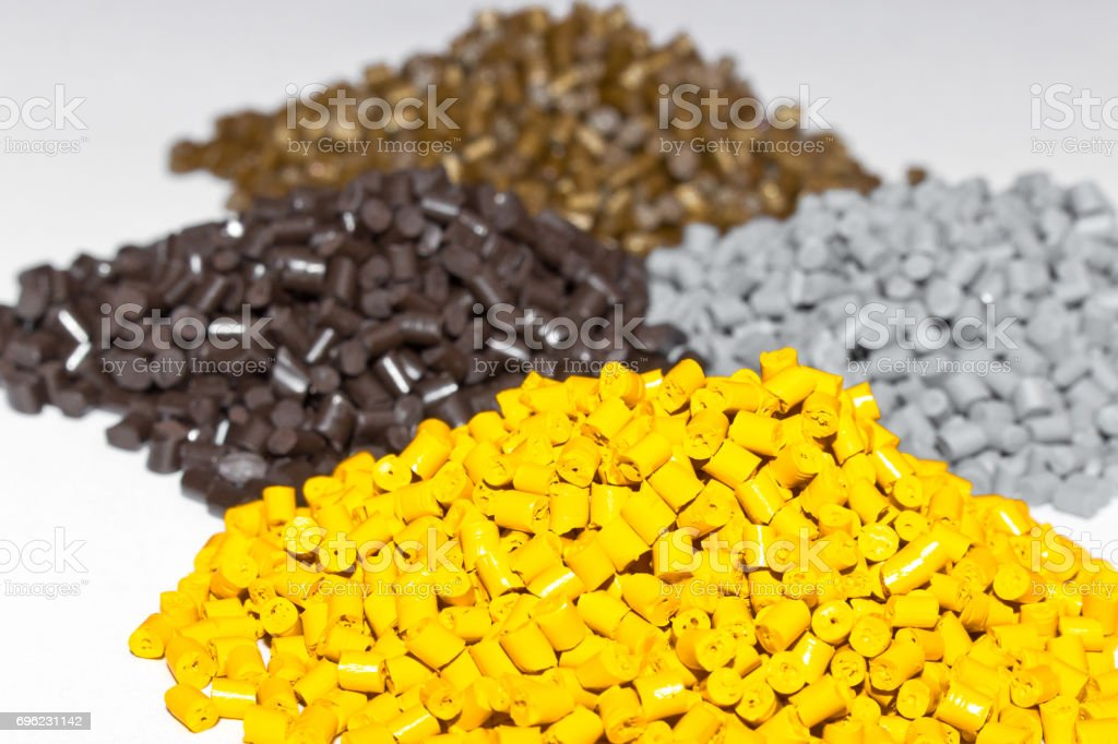 Plastic pellets on the table in the laboratory. Polymeric dye. Colorant for plastics in the granules. stock photo
