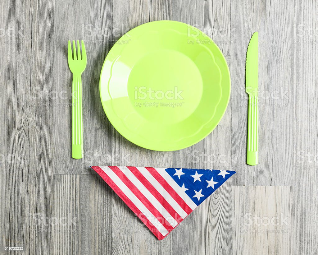 Plastic Plate, Fork, Knife,Napkin And American Flag  On Table stock photo