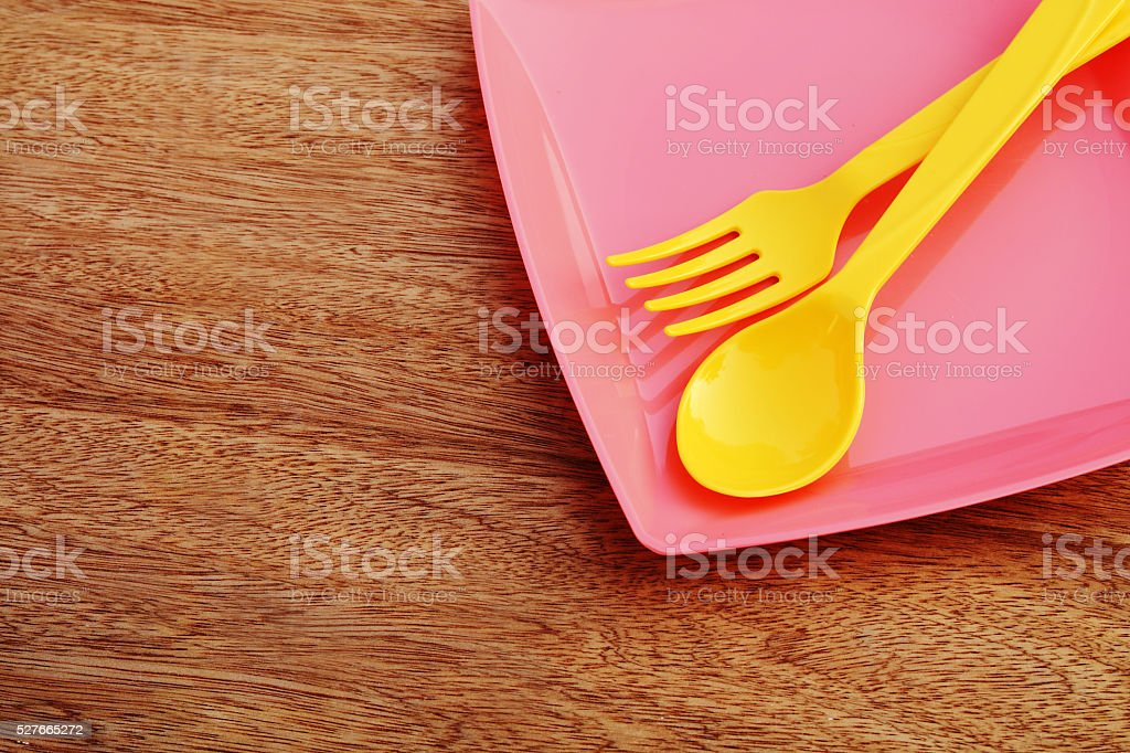 plastic plate spoon and fork stock photo