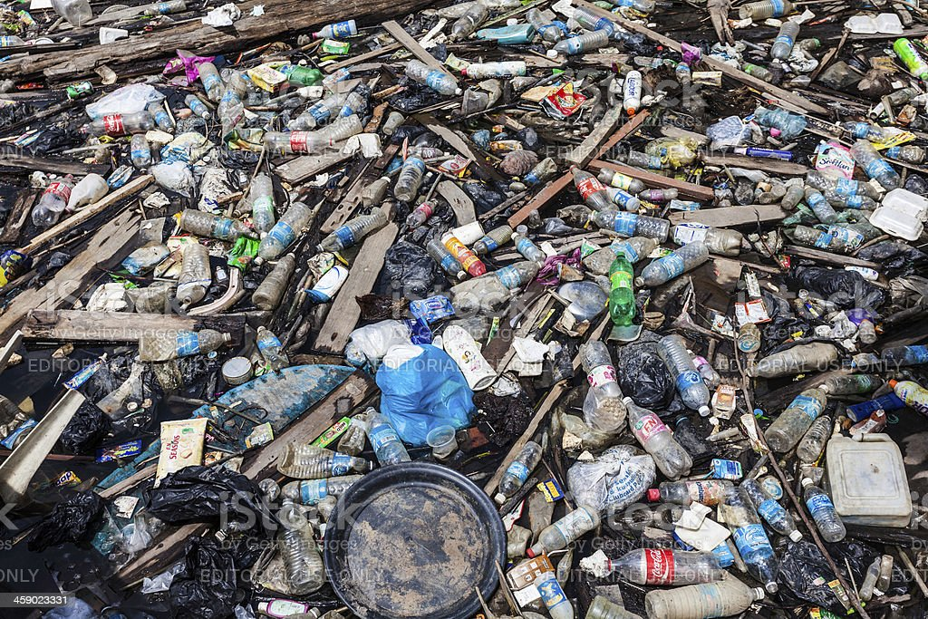 Plastic Pollution, Garbage Floating on Water royalty-free stock photo