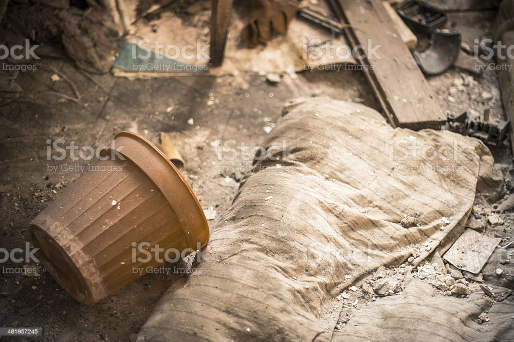 Plastic pot in old abandoned room royalty-free stock photo