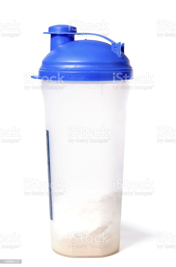Plastic protein shaker with blue top and whey powder royalty-free stock photo