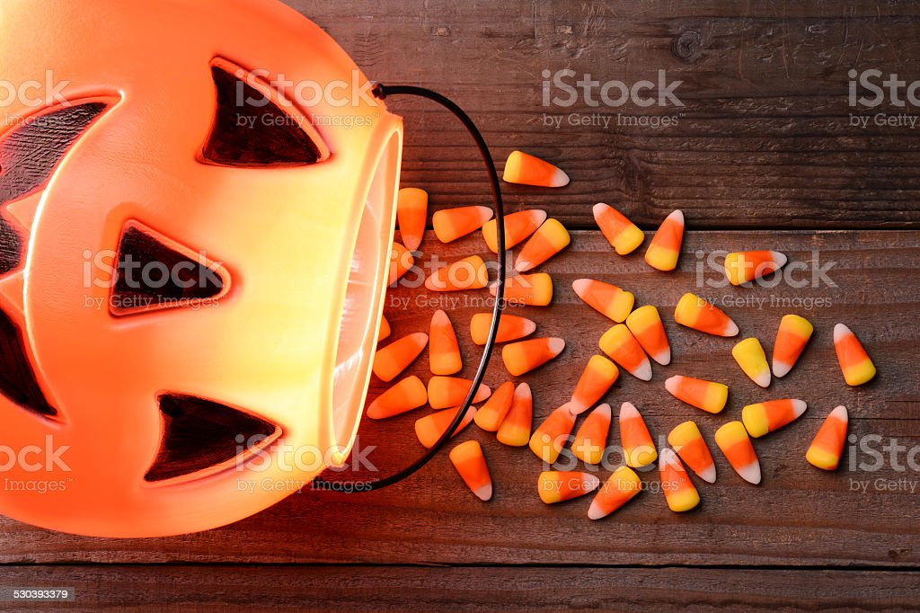 Plastic Pumpkin and Candy Corn Spill stock photo
