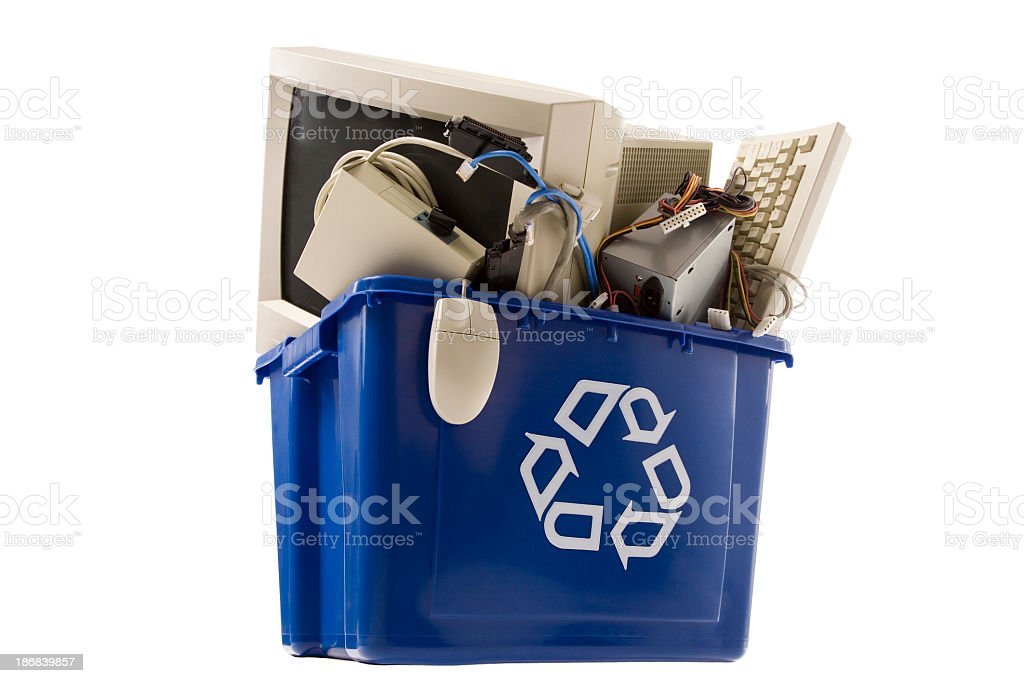 A plastic recycling box full of old technology equipment royalty-free stock photo