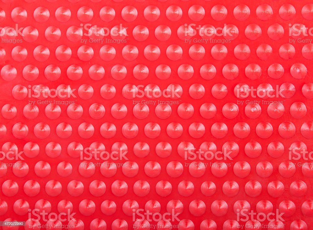 Plastic Red Background with Many Cone Round Dots stock photo