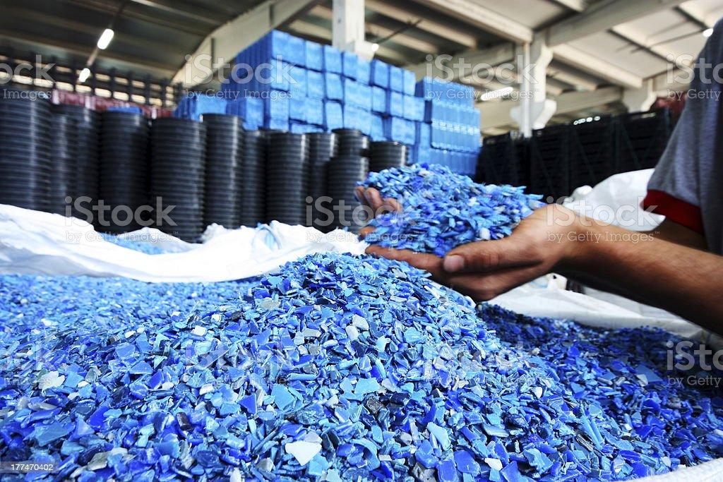 Plastic Resin pellets in holding hands stock photo