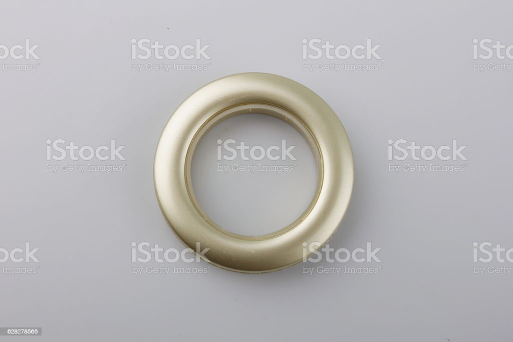 Plastic rings for fastening the fabric to the cornice. stock photo