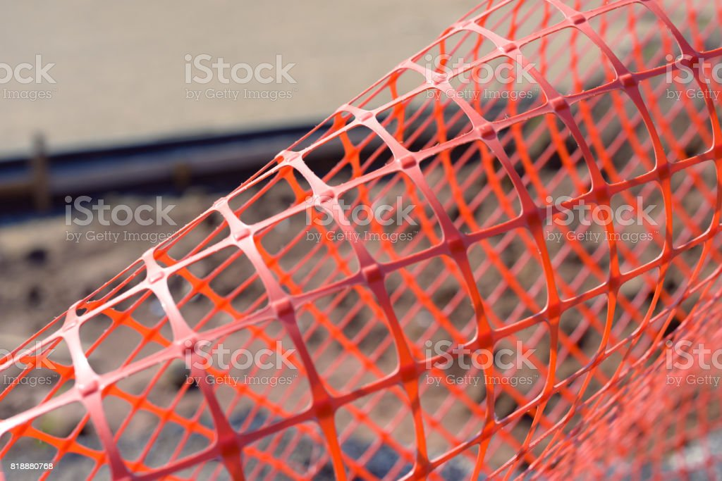 Plastic safety net for construction site. Construction mesh. stock photo