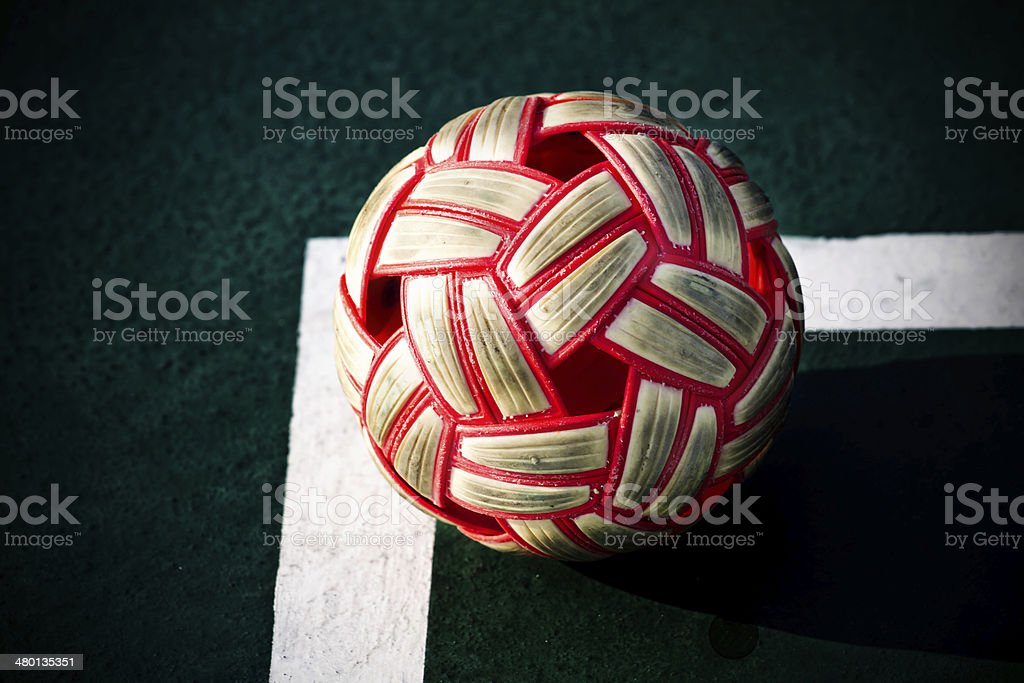 Plastic Sepak takraw ball on the cement floor. royalty-free stock photo