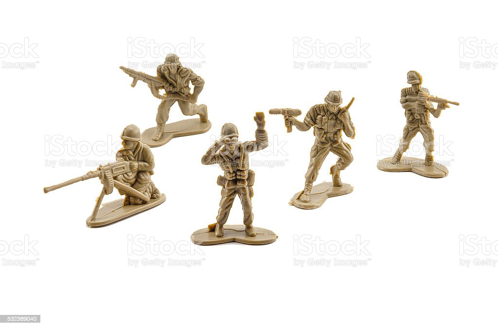 Plastic soldiers on white background. stock photo