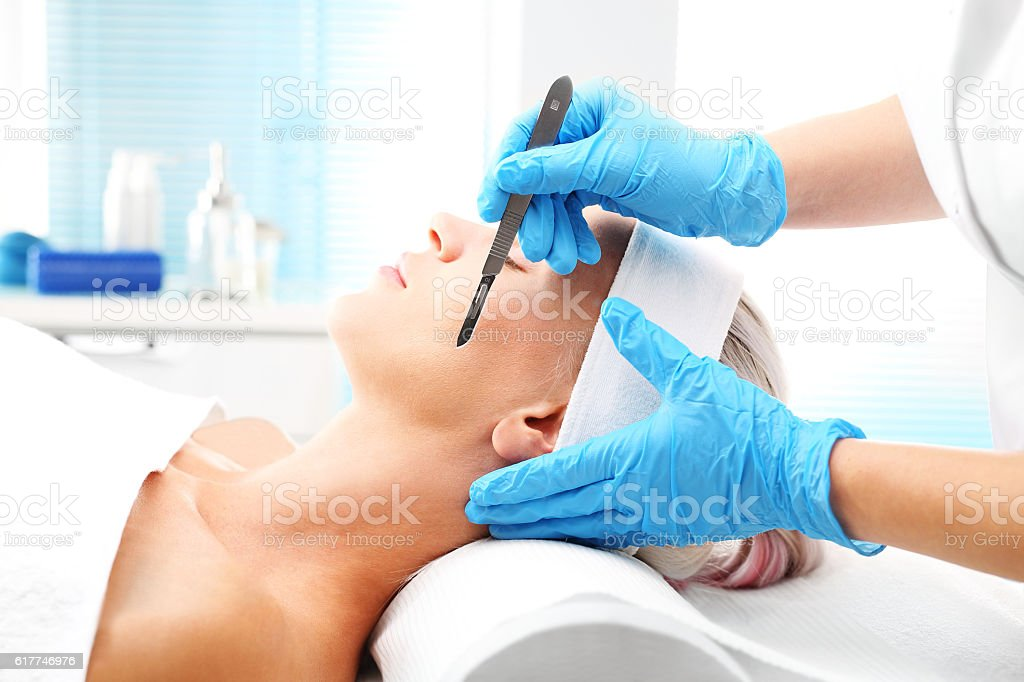 Plastic surgery, a woman in a plastic surgery clinic. stock photo