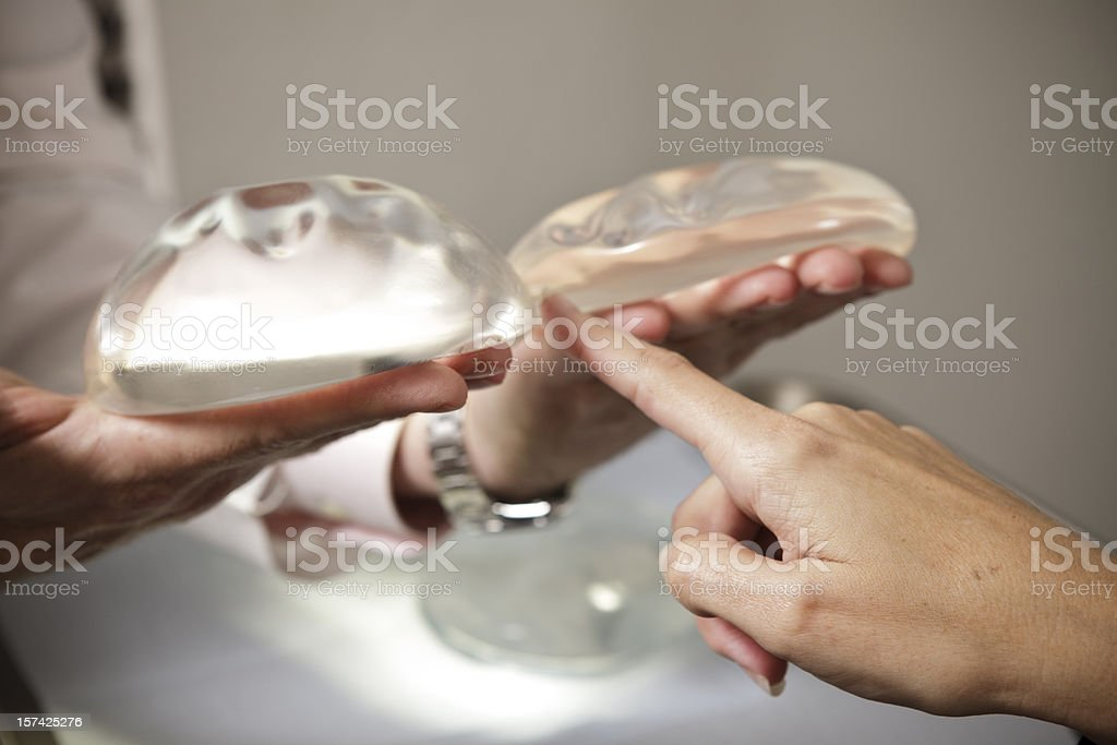 Plastic Surgery Patient Selects Larger Breast Implant stock photo