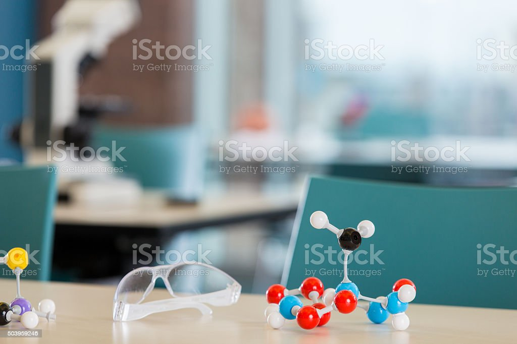 Plastic toy molecule models on desk in science lab classroom stock photo
