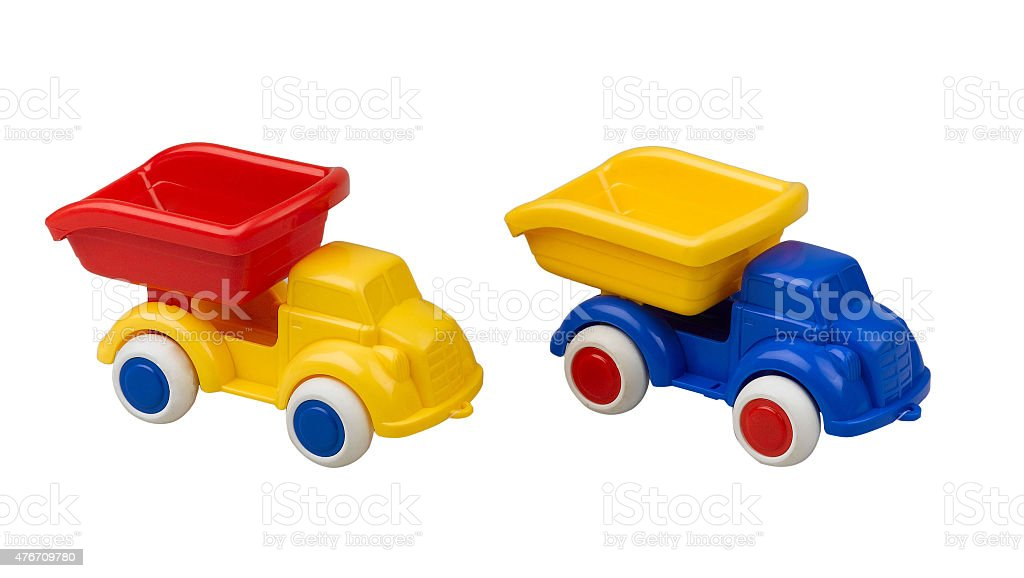 Plastic toy trucks for kid isolated stock photo