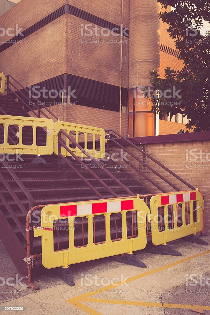 plastic traffic barriers in closed industrial area. stock photo