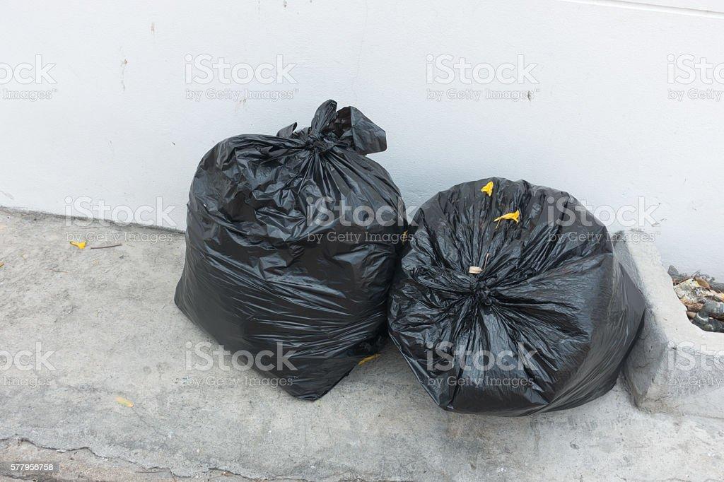 Plastic trash bags on outside street stock photo