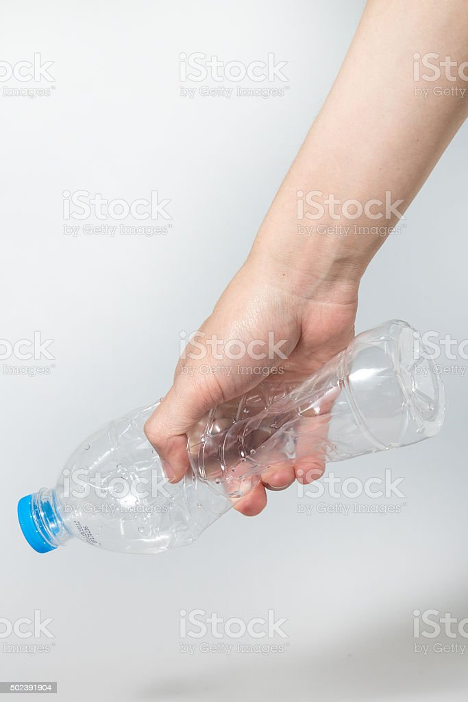 Plastic twist bottle in hand stock photo