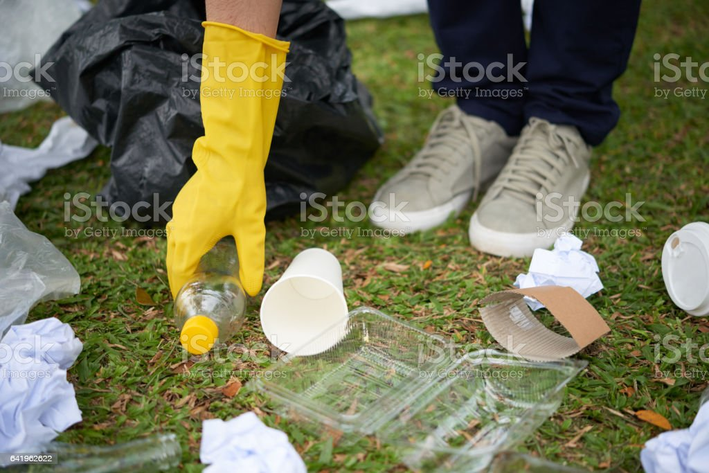 Plastic waste on grass stock photo