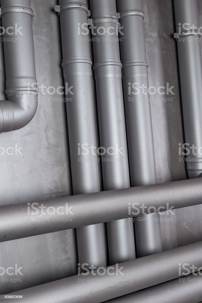 Plastic water pipe on the wall stock photo