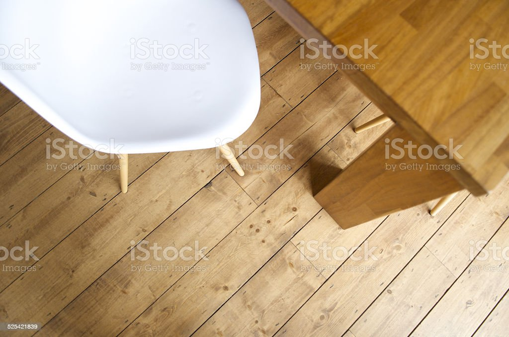 plastic white chair and wooden table and floor stock photo