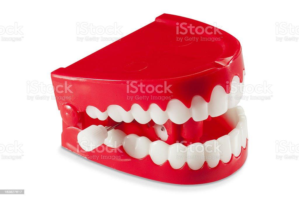 Plastic wind-up chattering joke teeth on white background stock photo