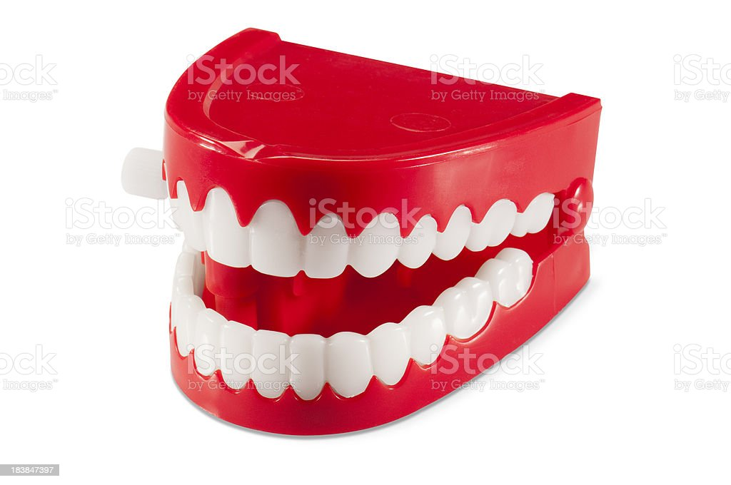 Plastic wind-up chattering joke teeth on white background stock photo