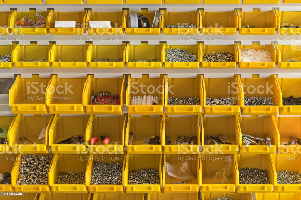 Plastic yellow boxes with instruments on wall stock photo