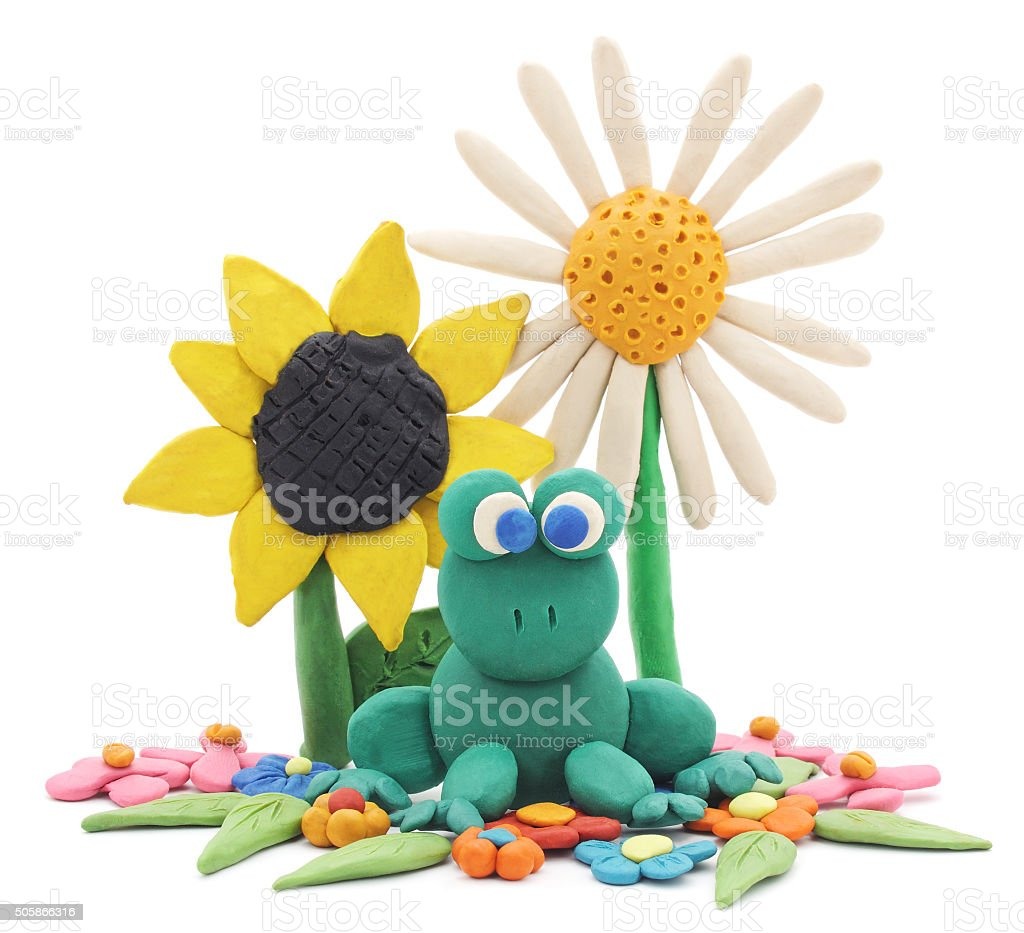 Plasticine frog and flowers. stock photo