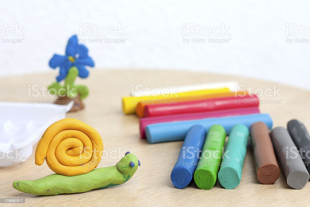 Plasticine on table with snail abstract background stock photo