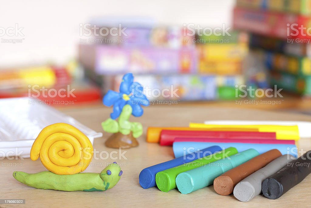 Plasticine on table with snail stock photo