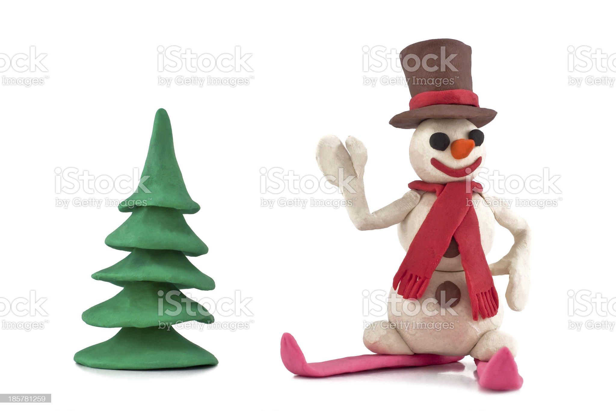 plasticine skiing snowman standing near the Christmas tree royalty-free stock photo