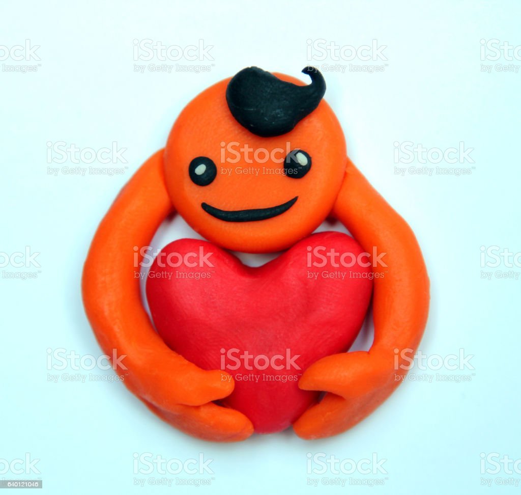 plasticine smiling man with a big heart stock photo