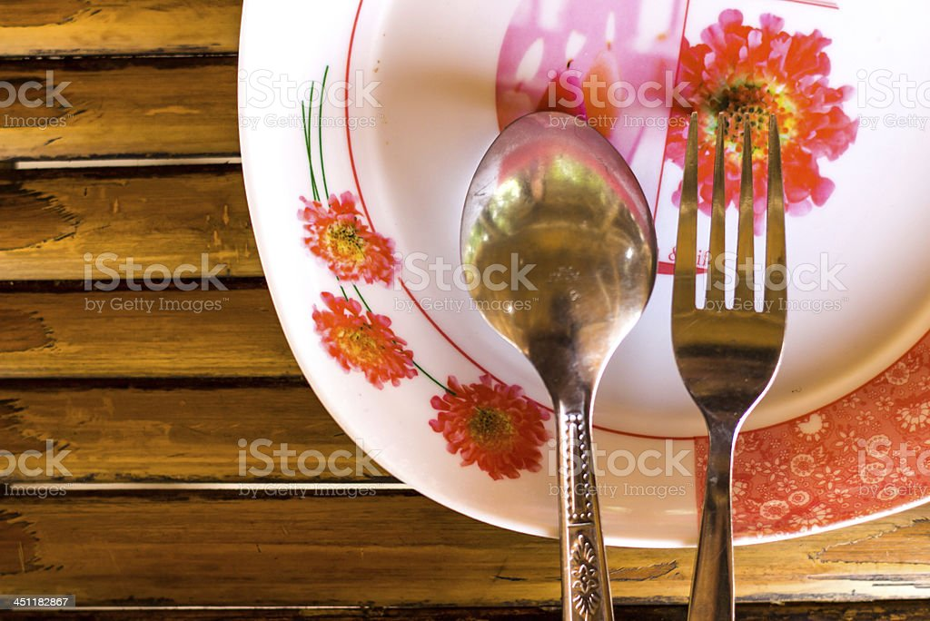 Plate and spoon. royalty-free stock photo