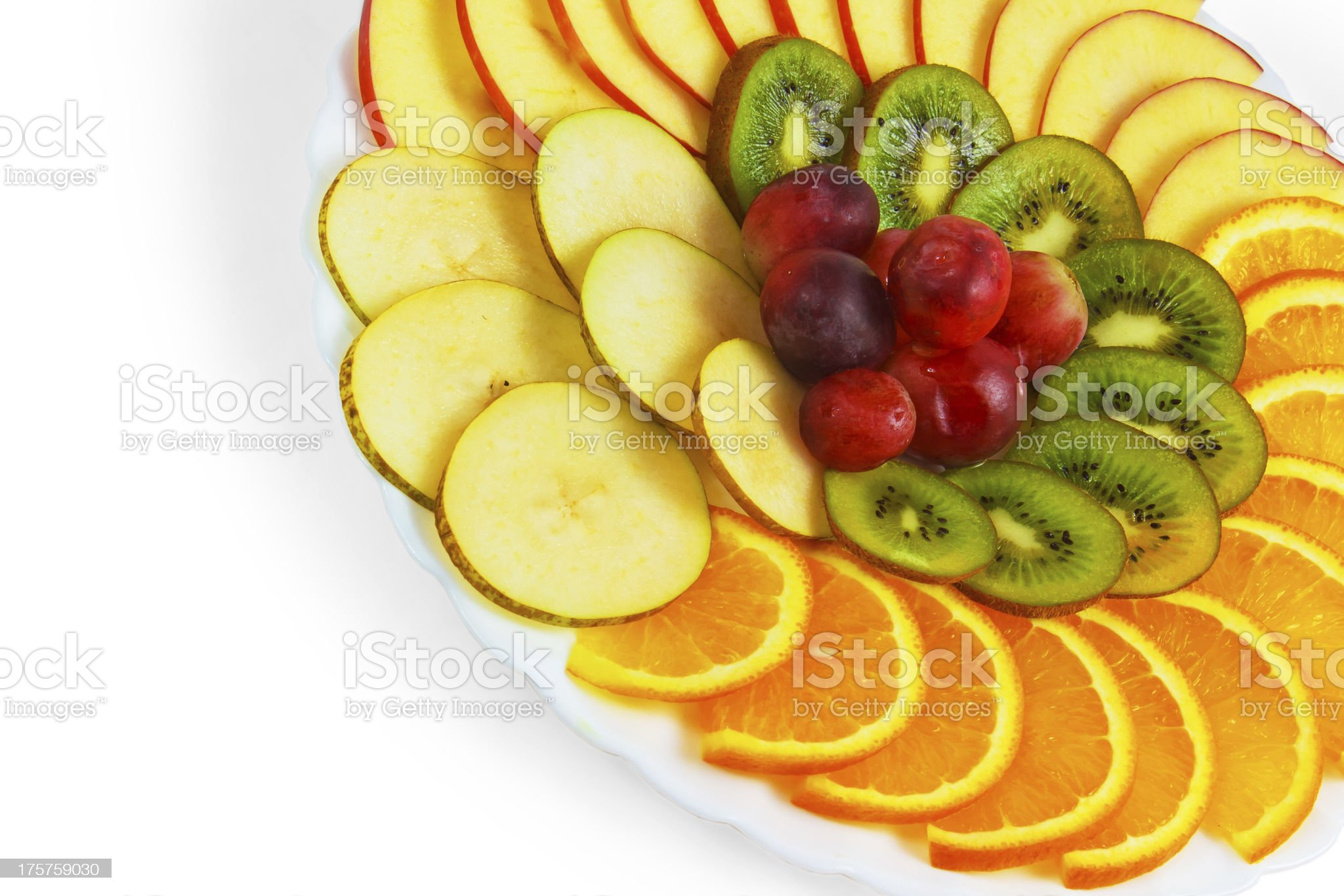 plate apple kiwi a grapes sliced isolated on white background royalty-free stock photo
