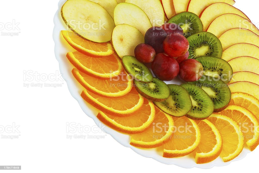 plate apple kiwi grapes sliced food isolated on white background royalty-free stock photo