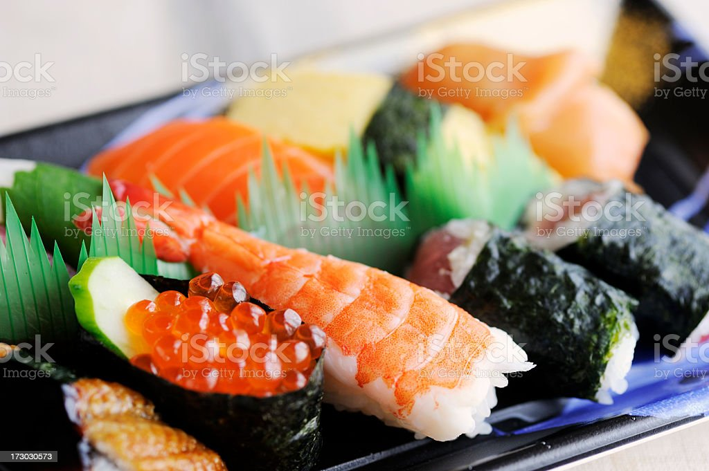 A plate displaying different types of sushi and sashimi stock photo