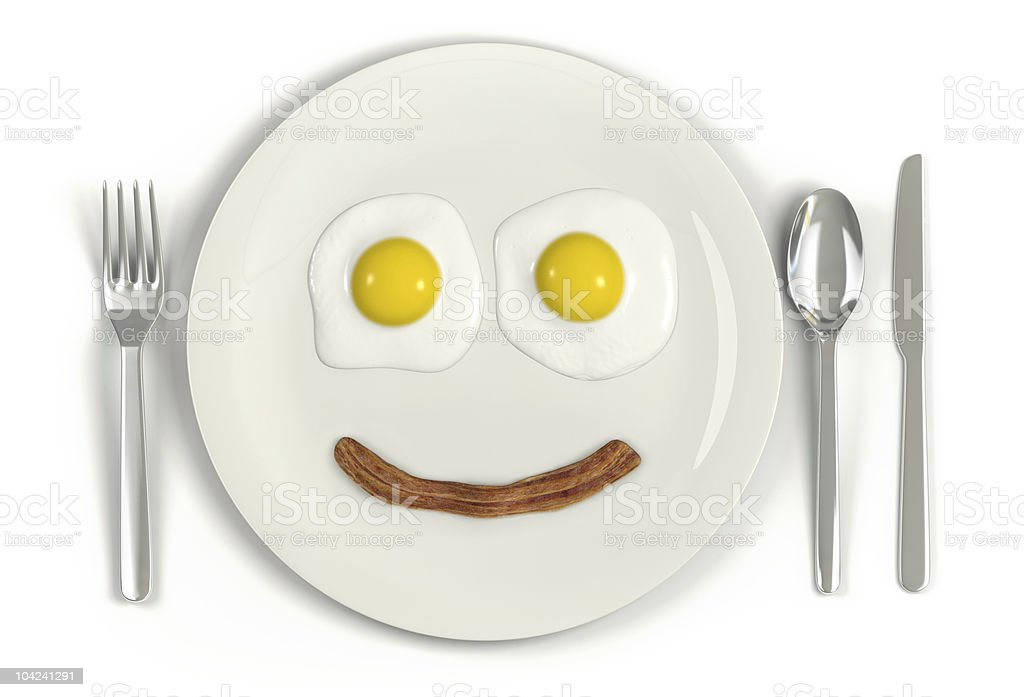 Plate featuring breakfast smile using eggs and bacon stock photo