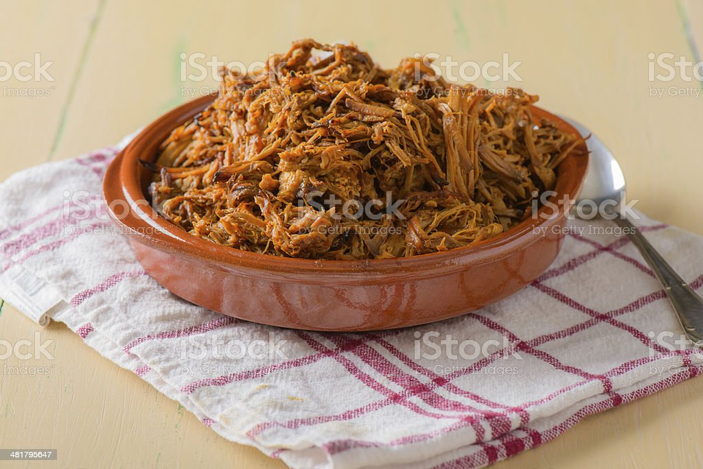 Plate filled with pulled pork on a round dish stock photo