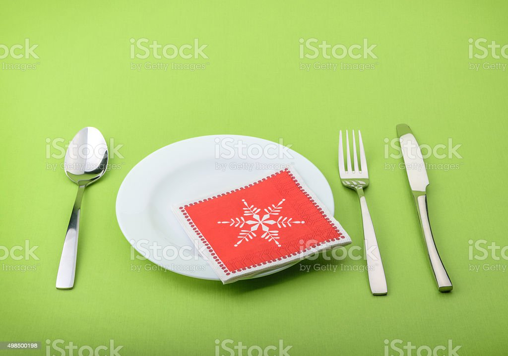 Plate fork and knife in a christmas napkin stock photo