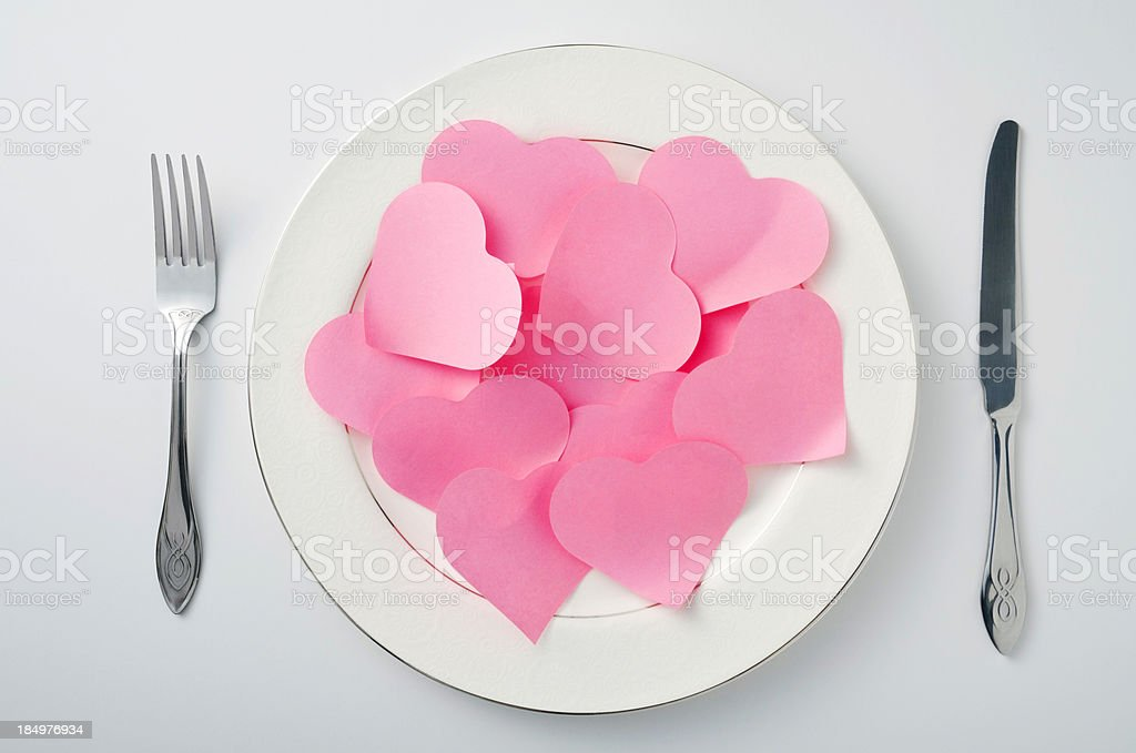 plate, fork, knife and red heart stock photo