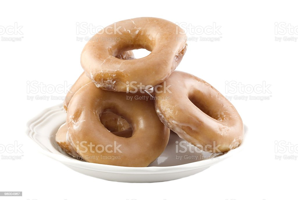 Plate Full of Glazed Donuts stock photo