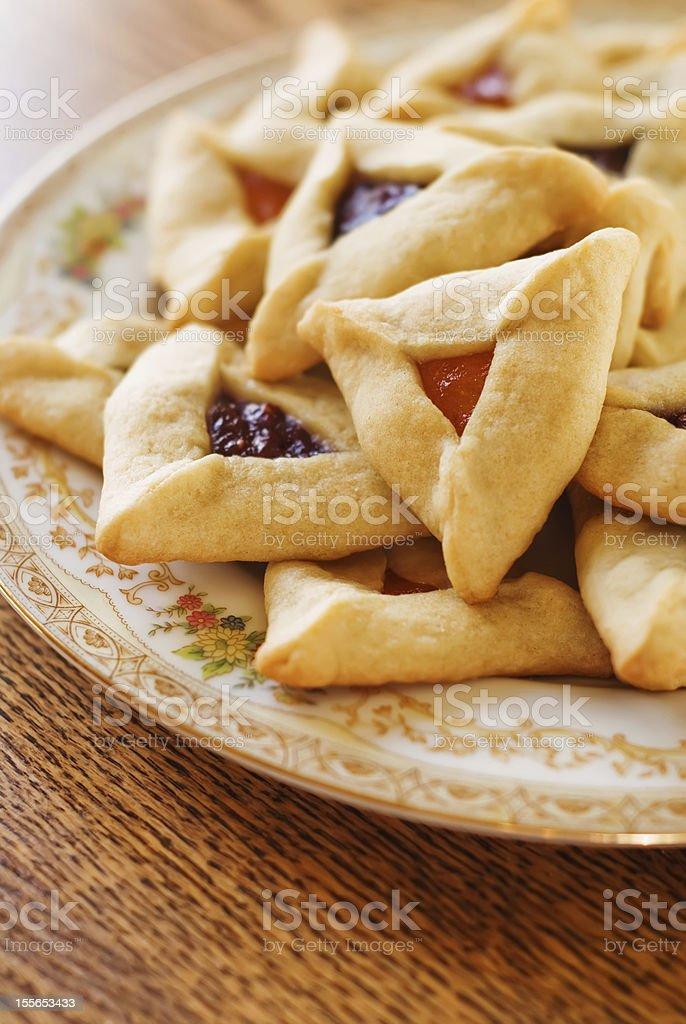 Plate full of hamantaschen cookies stock photo