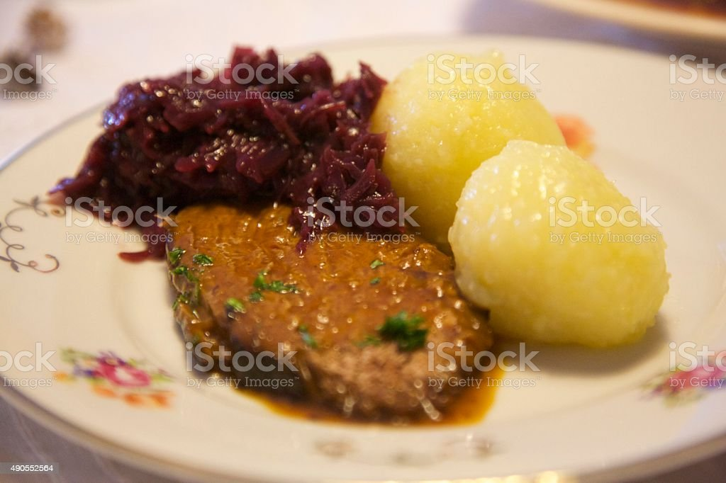 Plate full of meat and potatoes stock photo