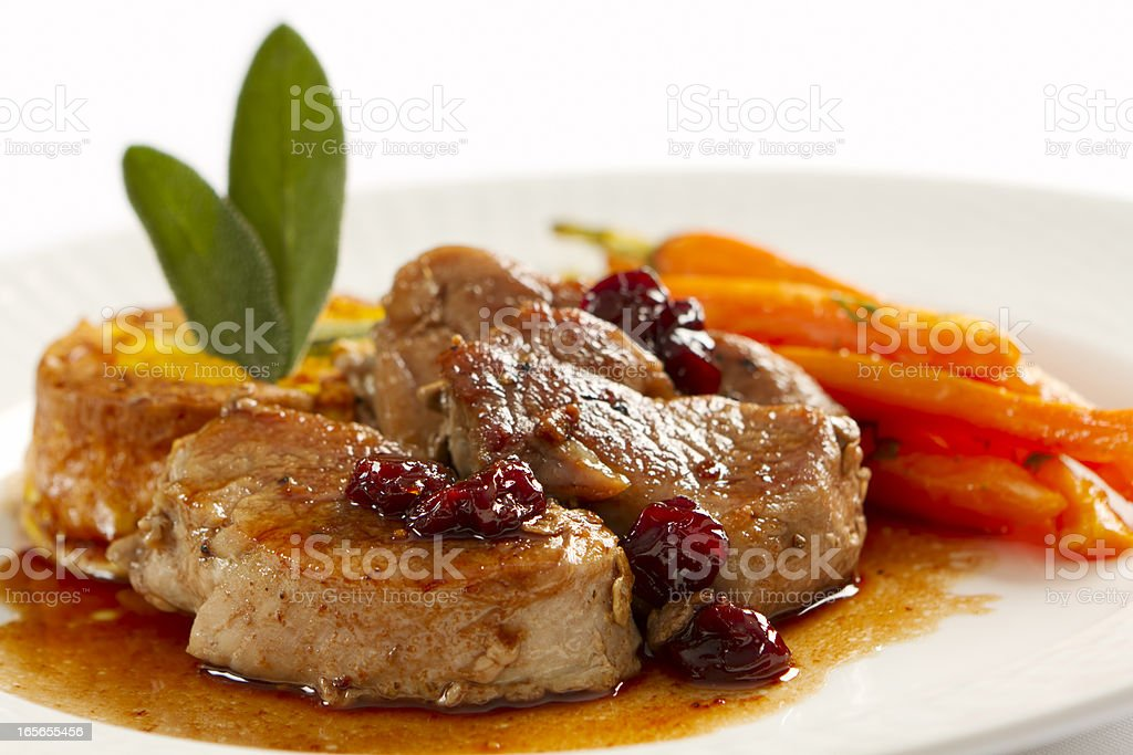 Plate full of pork loin medallions and carrots stock photo