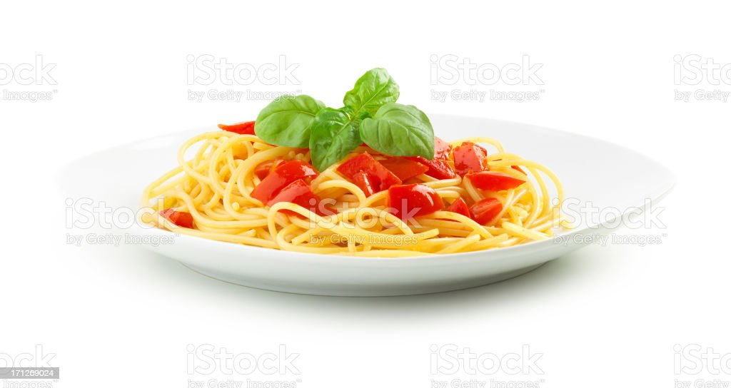 Plate full of spaghetti pasta with tomatoes stock photo